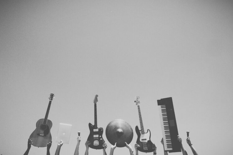 hands holding instruments up in the air