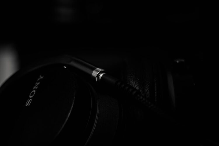 Dark background, close up of black Sony headphones