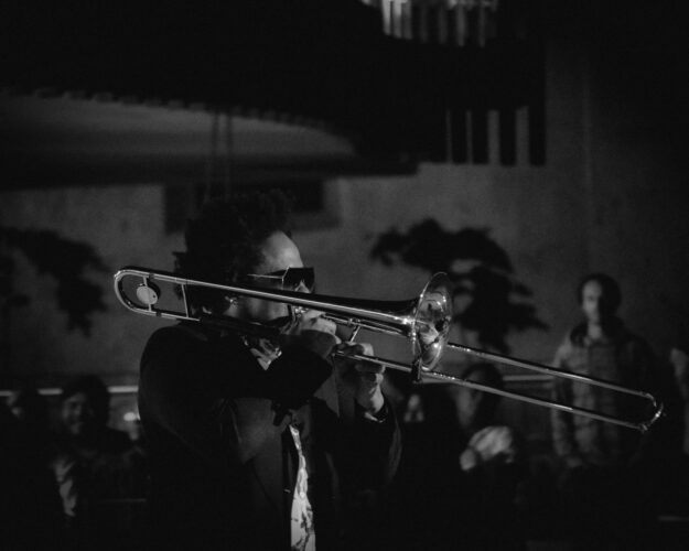 someone playing a brass instrument in a jazz band