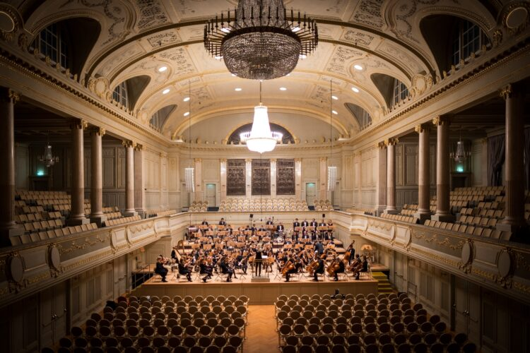 A band playing classical music in a concert hall