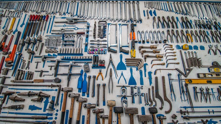 a huge table of tools used to fix a harmonica