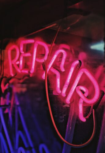 a neon light sign that reads