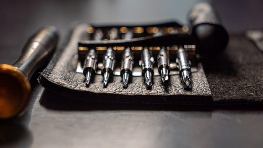 a leather roll of drill bits and other harmonica-fixing tools
