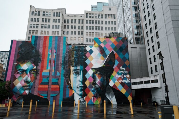 mural portrait of Bob Dylan on side of building